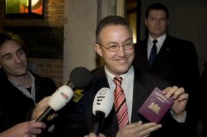 Ahmed Aboutaleb showing one of his two passports after questions about his loyalty to The Netherlands